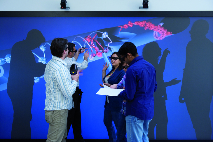 Researchers in the CAVE, a virtual reality simulation chamber