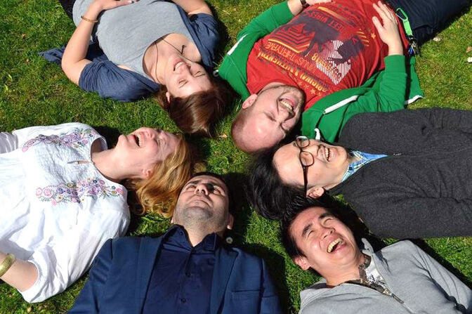 International students lying on the grass