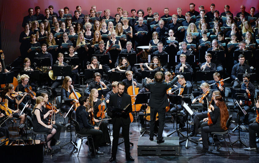 Choir and orchestra on theater stage